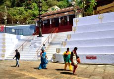 Temple worshippers in New Mangalore. New Mangalore, India - January 2017:White steep steps and seating area royalty free stock image