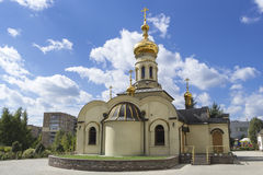 Temple of Xenia of St. Petersburg in Donetsk. Ukraine, 2016. Orthodox church. Golden domes and crosses under blue sky royalty free stock photos