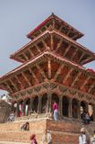 Temple with young people on steps, Durbar Square, Kathmandu, Nepal. March 2014 stock images