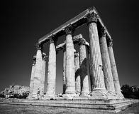 Temple Of Zeus. The Temple of Zeus in Athens, Greece with a glimpse of the Parthenon and the Acropolis at the lower left edge. (Scanned from black and white film Royalty Free Stock Image