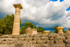 The Temple of Zeus ruins in ancient Olympia, Peloponnes, Greece. Low angle view at The Temple of Zeus ruins in ancient Olympia, Peloponnes, Greece Royalty Free Stock Photo