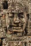 Temples of Angkor - Faces of Bayon temple Royalty Free Stock Photography