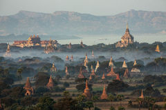 Temples of Bagan - Myanmar (Burma). The temples of the Archaeological Zone in Bagan in the early morning sunlight. In the distance is the Irrawaddy River Royalty Free Stock Photos