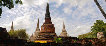 Temples in Ayutthaya. With partly cloudy sky royalty free stock photo