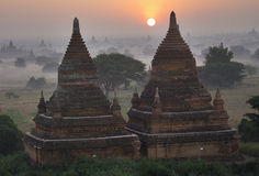 Temples of Bagan in early morning with Sun. Myanmar (Burma). Stock Images