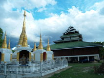 Temples and chedis. Pai, Thailand. A chedi and a buddhist temple in Pai, Thailand Stock Image
