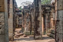 Discovered in the midst of the Cambodian jungle the Angkor Complex. Temples emerge from the Cambodian jungle to once again amaze us with what marvels ancient man royalty free stock photography