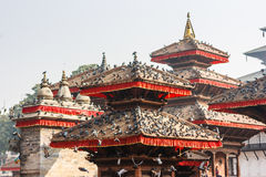 Temples of Kathmandu`s Durbar square, covered with pigeons Royalty Free Stock Photography