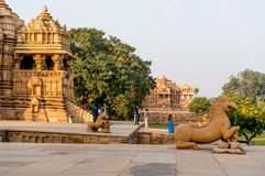 Temples at Khajurao India. Khajurao, India, 6th Dec 2015: Visitors going to the temples at khajurao during the evening Stock Images