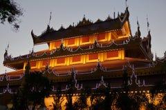 Temples and pagodas in Mandalay at night Stock Photos
