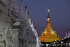 Temples and pagodas in Mandalay at night Stock Photography