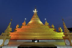 Temples and pagodas in Mandalay at night Stock Photo