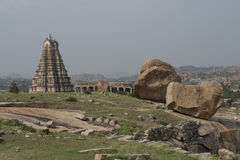 Temples and ruins of Hampi, India. Archaeological complex of temples and ruins of Hampi, India. Landscape with temples stock image