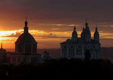 The temples at sunset. Domes of Orthodox churches against the bright evening sunset Royalty Free Stock Photography