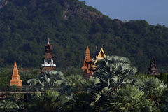 Temples in Thailand. Scenic view of buddhist temples in jungle with mountain in background, Thailand royalty free stock photo