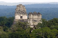 Temples of Tikal. Temples I and II of Tikal rising above the canopy of the Petén forest, Tikal National Park, Guatemala Stock Photo