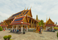 Temples and tourists at Bangkok's Grand Palace. Royalty Free Stock Image