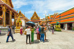 Temples and tourists at Bangkok's Grand Palace. Royalty Free Stock Photos