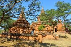 Temples between trees in Bagan Stock Photo