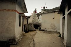Templet ser som hus av GUDEN royaltyfri foto