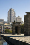 Templo de Debod and skyscraper. Egyptian Temple of Debod with skyscrapers of Madrid in the background providing an example of the contrasting architectural Stock Photo