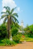 Templo religioso , relojes hechos de flores Fotografía de archivo libre de regalías