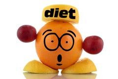 Tempo da dieta. Caráter engraçado do fruto. Imagens de Stock