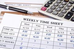 Tempo de funcionamento calculador do empregado fotografia de stock royalty free