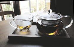 Tempo del tè sul piatto di legno Immagine Stock
