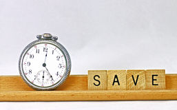 Tempo di salvare Fotografie Stock Libere da Diritti