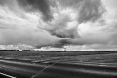 Tempo di Stormic sulla strada Immagine Stock