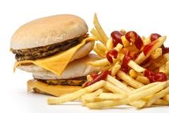 Tempo do almoço com as fritadas do cheeseburger e do francês fotografia de stock royalty free