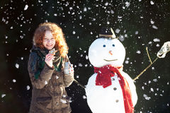 Tempo do chá com um boneco de neve Foto de Stock Royalty Free