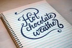 Tempo do chocolate do backgroundHot das uvas, no caderno espiral velho Fotos de Stock