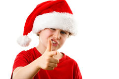 Tempo do Natal - menino com Santa Claus Hat Fotos de Stock Royalty Free