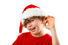 Tempo do Natal - menino com Santa Claus Hat Foto de Stock Royalty Free