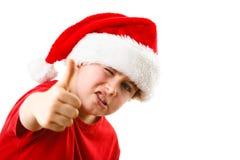 Tempo do Natal - menino com Santa Claus Hat Imagem de Stock