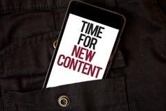 Tempo do texto da escrita da palavra para o índice novo Conceito do negócio para o colo preto de publicação do telefone celular d fotografia de stock royalty free