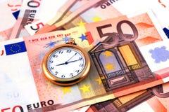 Tempo e dinheiro Foto de Stock