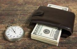 Tempo e soldi Fotografie Stock