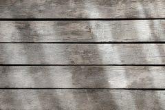Tempo e tavolato esposto del legno duro del tek Fotografia Stock