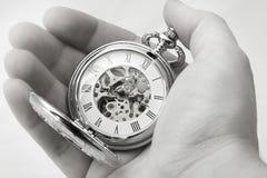 Tempo em suas mãos Imagens de Stock