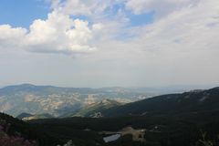 Tempo nuvoloso nelle montagne Fotografia Stock