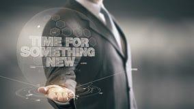 Tempo per qualche cosa di nuove tecnologie disponibile di Holding del nuovo uomo d'affari Immagine Stock Libera da Diritti