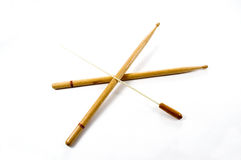Tempo Setters. A pair of drumsticks with a conductor's baton Stock Photography