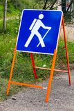 A temporary blue hiking sign for a trail Stock Photo