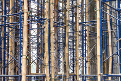 Temporary bracing scaffolding. Close up on bamboo scaffolding steel, which is currently serving temporary bracing in construction Royalty Free Stock Image