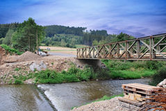 A temporary bridge. Over  river in the workplace Royalty Free Stock Photography