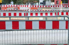 Rows of safety barriers at construction site. Temporary fencing with metal safety barriers at construction site with red and white pattern royalty free stock image