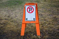 A temporary no parking barrier with right and left arrows.  Royalty Free Stock Images